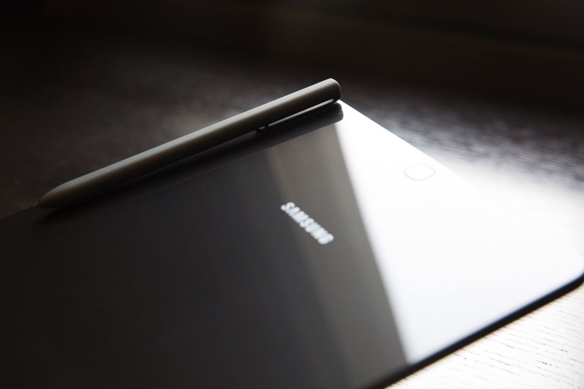 The S Pen doesn't slot into the Tab S3, but at least it clips to the back using magnets.