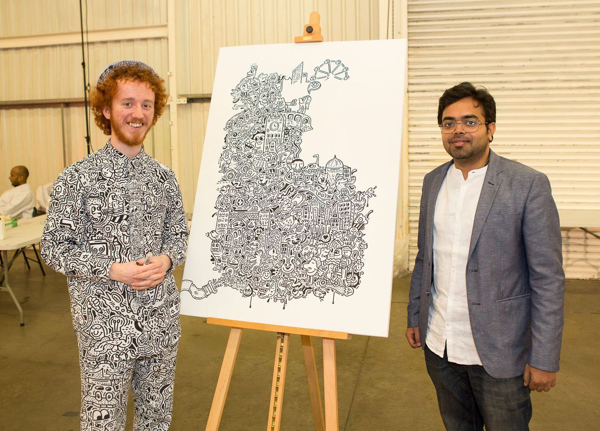 Mr Doodle (left) and Anirudh Sharma join forces for some air pollution art in London.
