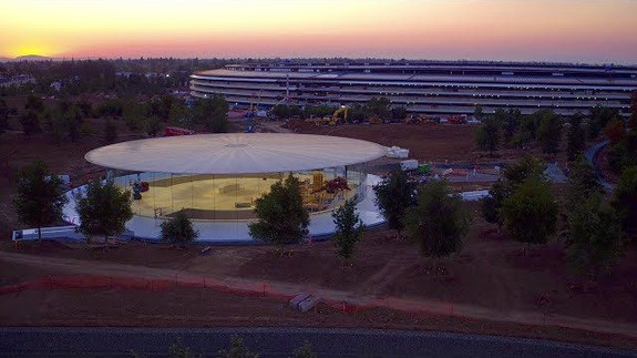 Drone footage shows Apple's nearly finished spaceship campus against stunning sunset