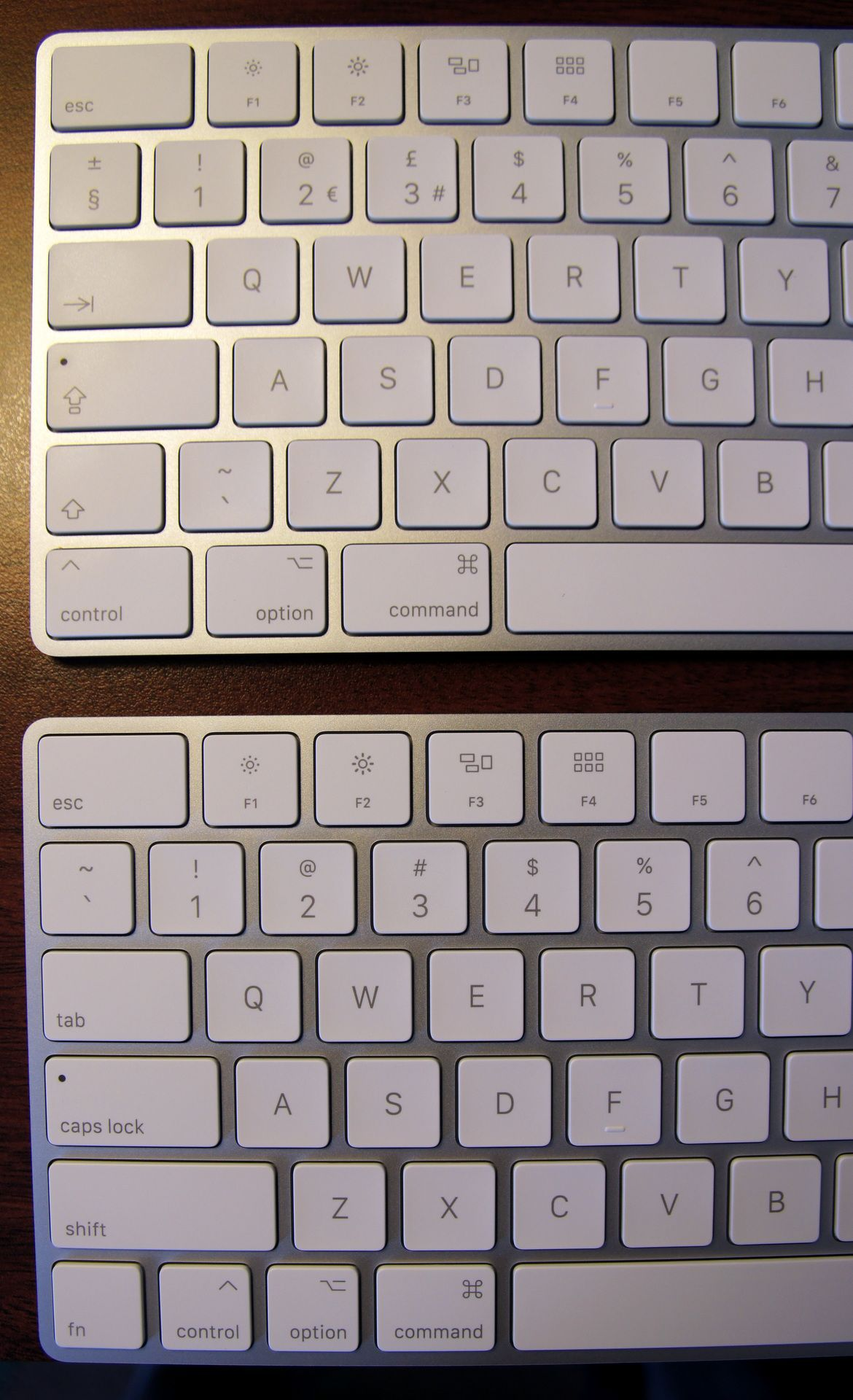 You have to give up  something. The Magic Keyboard (top) has a smaller Shift key.