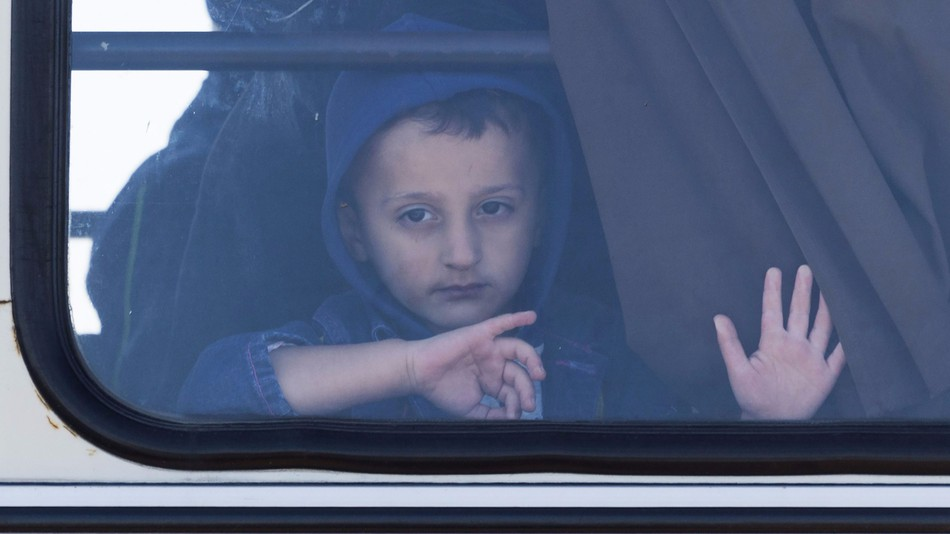 Migrants ride a bus along the border of Hungary and Serbia.