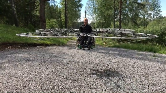 Watch this brave inventor man his homemade flying chair for the first time