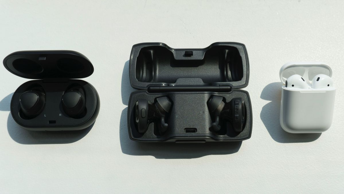 The SoundSport Free charging case (center) is HUGE compared to the Gear IconX 2018 (left) and AirPods (right).