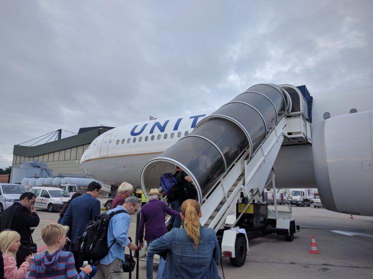 Passengers boarding an airplane.