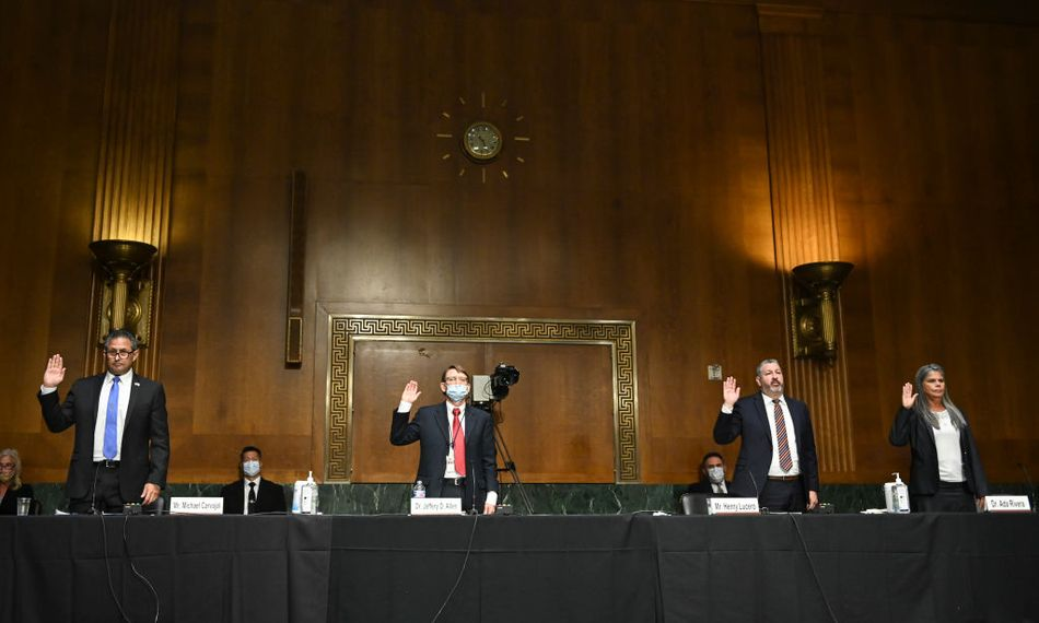 Federal Bureau of Prisons Director Michael Carvajal, left, is sworn in before a June Senate Judiciary Committee hearing on incarceration during COVID-19.