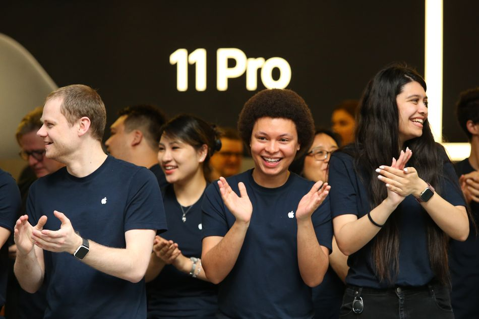 Apple Store employees happy to see their customers.