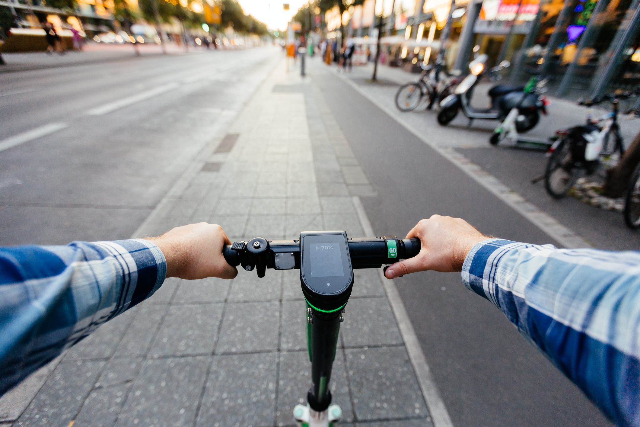 First person view of riding an e-scooter in a city