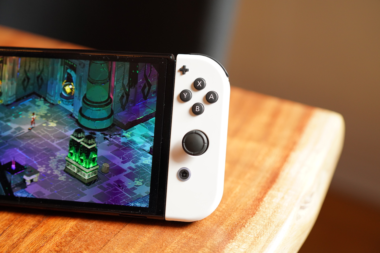 The Nintendo Switch OLED on a table.